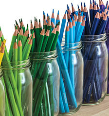 Coloured pencils in glass jars.